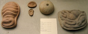 Votive offerings found at the sanctuary in the shape of a womb, an eye, an ear, a breast, and internal organs.