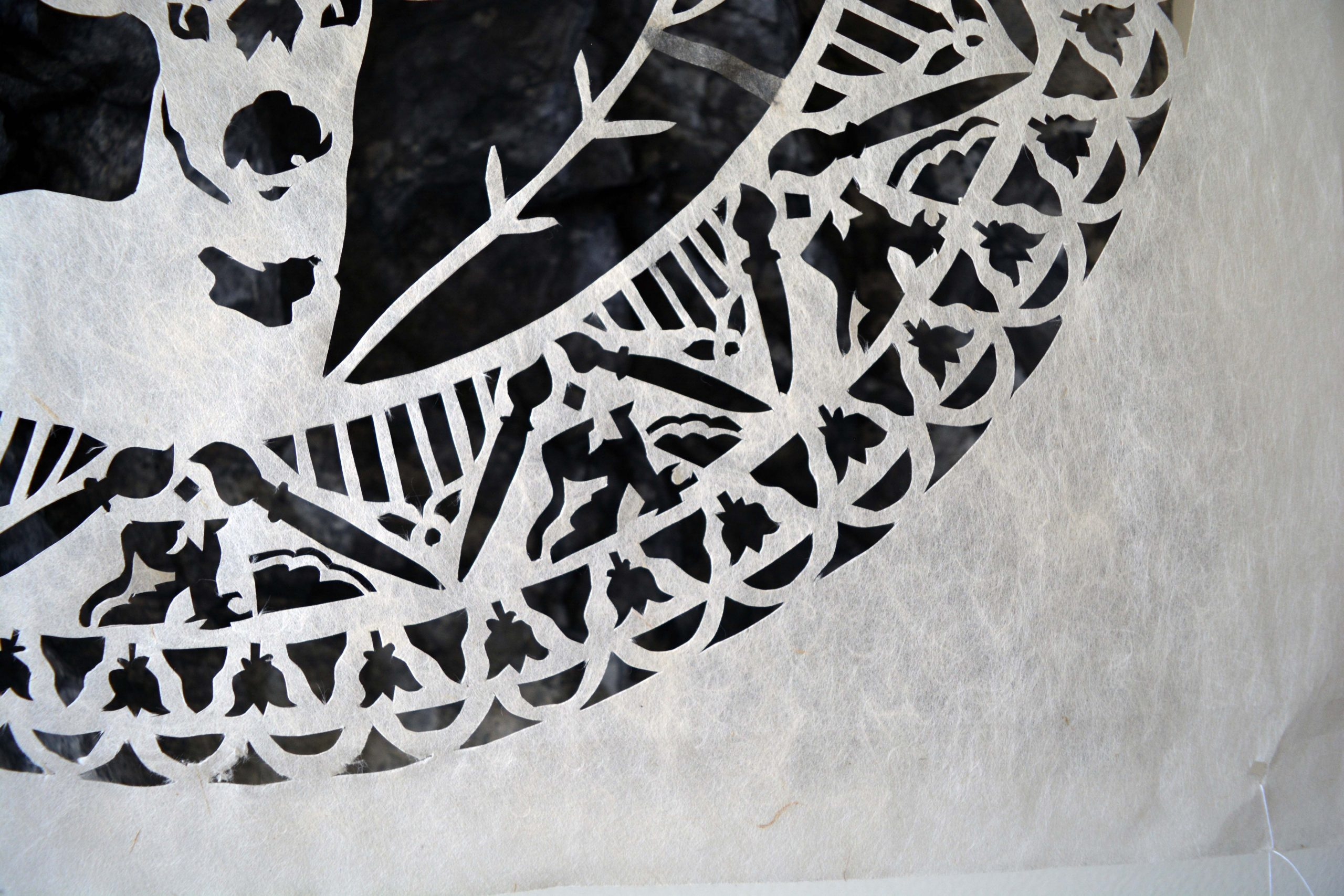 detail of kozo paper, cut with various designs, including a deer