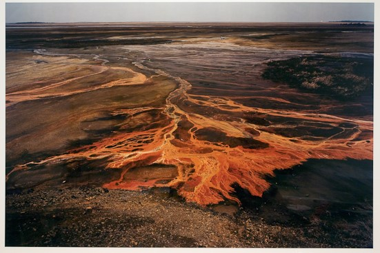What elements of this photograph stand out for you? Do you think this photograph is beautiful? What attitude do you think the photographer has towards nature? How does finding out that the intense colors in this photograph are due to toxic chemicals that have been dumped onto the land?